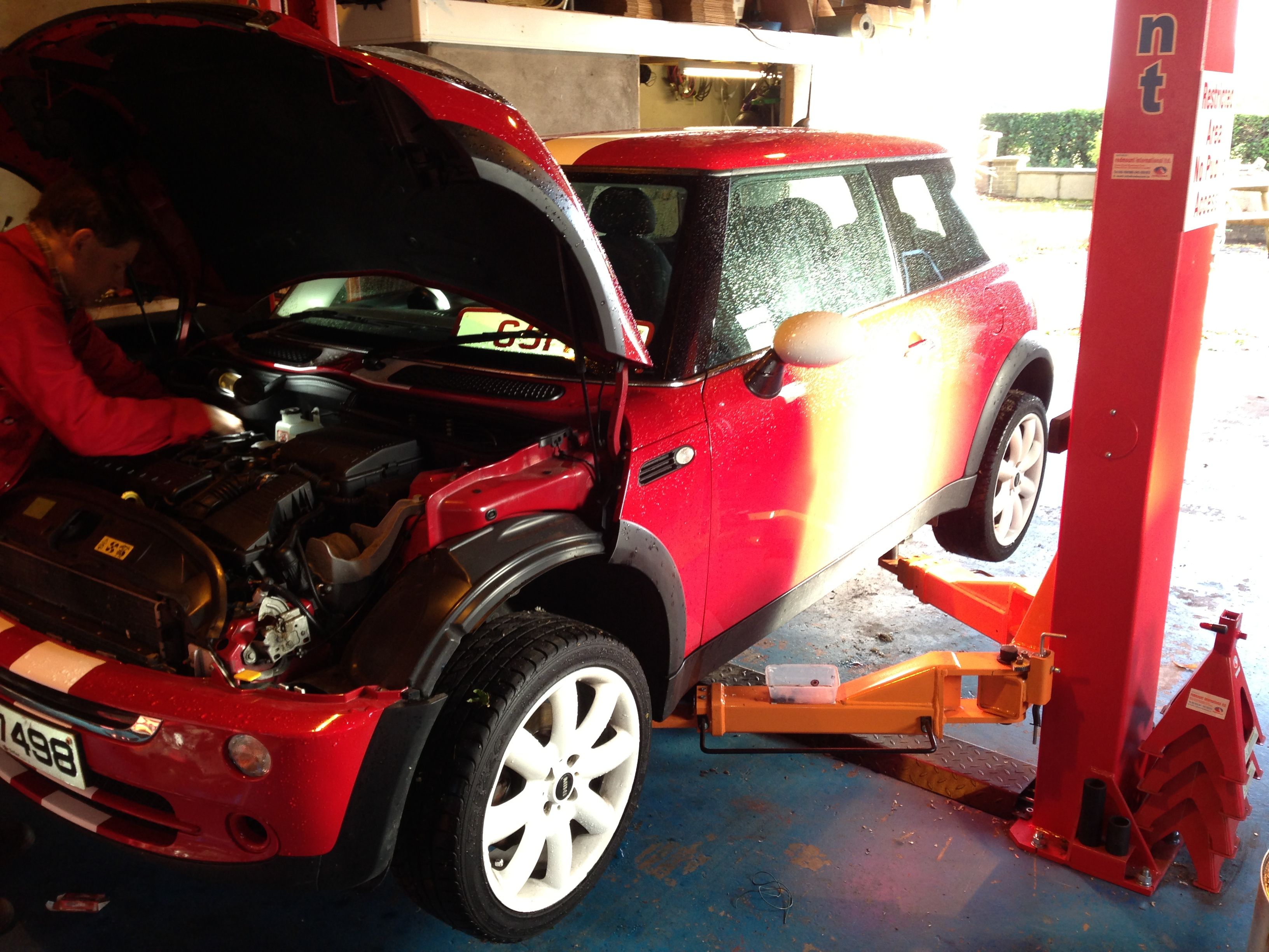 Servicing Mini Car At NI Vans